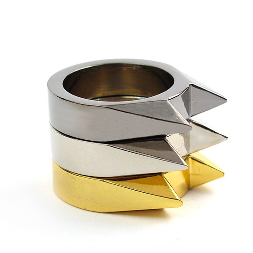 "Three ""cat ear"" self-defense steel rings in black, silver, and gold."