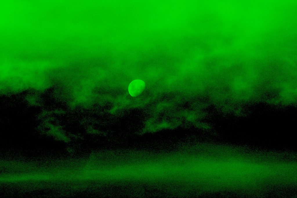 Green, night vision image of the night sky