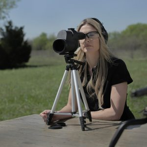 woman spotting scope